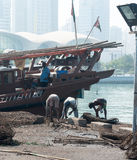 Migrant workers at the dhow harbour, Abu Dhabi Stock Photo