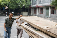 Migrant workers in the street Stock Image