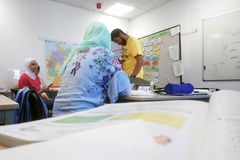 Migrants from Africa, Asia and the Middle East learn German in the class of the international school Inlingua in Halle Saale,. Germany, 29.052018 stock images