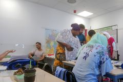 Migrants from Africa, Asia and the Middle East learn German in the class of the international school Inlingua in Halle Saale,. Germany, 29.052018 stock photography