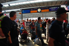 Migrants arriving at Munich Central Station. Migrants arriving from Austria at Munich Central Station, are directed by police towards a waiting train that will Royalty Free Stock Photos