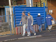 Migrants in construction. Migrants working in construction during lunch break on street stock photos