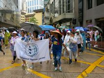 Migrants Marching in Protest. Migrant workers from the Philippines march at a protest in Hong Kong stock photo