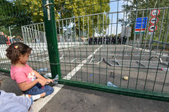 Migrants from Middle East waiting at hungarian border. HORGOS, SERBIA - SEPTEMBER 15 : A large group of refugees from Middle East at the closed hungarian border royalty free stock photo