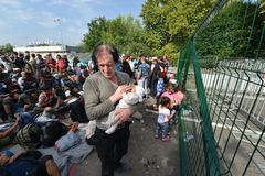 Migrants from Middle East waiting at hungarian border. HORGOS, SERBIA - SEPTEMBER 15 : A large group of refugees from Middle East at the closed hungarian border stock photos