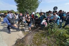 Migrants from Middle East waiting at hungarian border. HORGOS, SERBIA - SEPTEMBER 15 : A large group of refugees from Middle East at the closed hungarian border stock photo