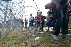 Migrants from Middle East waiting at hungarian border. HORGOS, SERBIA - SEPTEMBER 15 : A large group of refugees from Middle East at the closed hungarian border stock image