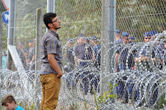 Migrants from Middle East waiting at hungarian border. HORGOS, SERBIA - SEPTEMBER 15 : A large group of refugees from Middle East at the closed hungarian border royalty free stock photos