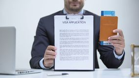 Migration agent holding visa application and passport, docs required to embassy. Stock footage stock video footage