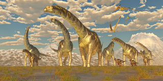 Migration de troupeau d'Argentinosaurus Photographie stock libre de droits