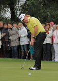 Miguel Angel Jimenez. plays his putt. Spain's Miguel Angel Jimenez, plays his shot during the 2011 Schüco Open, which was held at Hubblerath Germany Royalty Free Stock Photo