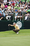 Miguel Angel Jimenez - Takes Aim. Miguel Angel Jimenez, takes aim on the 18th green. Putter in hand, ready to put out for the day Royalty Free Stock Image