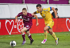 Mihai Roman Tackled by a Petrolul Opponent. Mihai Roman tackled by a Petrolul team's opponent  in Rapid Bucharest vs. Petrolul Ploiesti in Romanian Cup, 21 Stock Photography