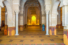 The mihrab in Grand Mosque. SOUSSE, TUNISIA - SEPTEMBER 6, 2015: The stone mihrab in the Grand Mosque in bright yellow illumination, on September 6 in Sousse Stock Photos