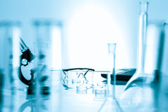 Miicroscope and plastic safety glasses in  lab Stock Images