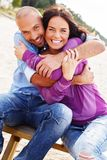 Miiddle-aged couple on a beach Royalty Free Stock Image