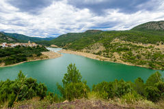 The Mijares or Millars is a river in Aragon and the Valencian Co. Picturesque panoramic landscape with Mijares river and Puebla de Arenoso town on the background Stock Photography