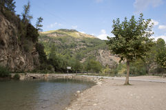 The Mijares river passing through the village of montanejos. In Castellon stock photography