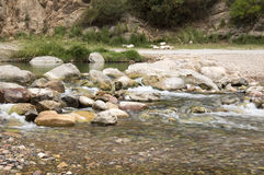 The Mijares river passing through the village of montanejos. In Castellon royalty free stock photography