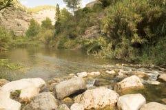 The Mijares river passing through the village of montanejos. In Castellon royalty free stock photo