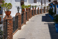 MIJAS, ANDALUCIA/SPAIN - JULY 3 : View of Brick Piers and Blue F. Lower Pots in Mijas   Andalucia Spain on July 3, 2017 Royalty Free Stock Photo