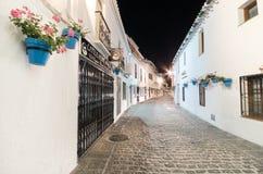 MIJAS, SPAIN - APRIL 30: Narrow alley in Mijas village at night on April 30, 2014. Mijas Is a famous touristic town with white hou Royalty Free Stock Photo