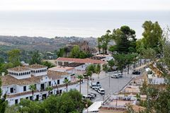Panorama of white village of Mijas. Costa del Sol, Andalusia. Spain. MIJAS, SPAIN - AUGUST, 29, 2017: Plaza Virgen de la Pena square with the Town Hall, Tourist Stock Image