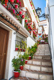 Mijas,Spain-2 May,2014:Street with flowers in the Mijas town, Sp Royalty Free Stock Photo