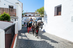 Mijas, Spain- September 29, 2015: A horse carriage in a street of Mijas village, Andalusia, Spain. Stock Photos