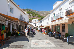 Mijas, Spain- September 29, 2015: One of the most popular streets in the white village of Mijas. Royalty Free Stock Photos