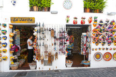 Mijas, Spain- September 29, 2015: Popular souvenirs shop with ceramics in the little white village of Mijas, Spain. Stock Photo