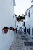 Mijas village. Narrow street receding past white washed houses in Mijas village, Andalusia, Spain Stock Image