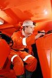Mijnwerker in de cockpit stock afbeelding