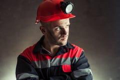 Mijnwerker die weg kijken royalty-vrije stock afbeeldingen