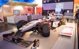 Mika Hakkinens 1999 kraschade MP4/14 västra McLaren Mercedes Formula 1 bil Royaltyfri Bild