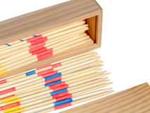 Mikado game. Wooden Mikado sticks and box isolated on white Royalty Free Stock Photo