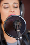 Mike And Condenser With Woman Singing In Studio Stock Photo