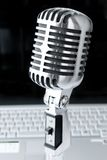Mike & Laptop. Professional Microphone Against Laptop Royalty Free Stock Images