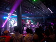 Mike Love Band plays music indoors. Honolulu - August 16, 2018: Mike Love Band plays music indoors with cool lighting at Crossroads at Hawaiian Brians in stock images