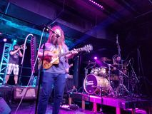 Mike Love Band plays music indoors. Honolulu - June 7, 2017: Mike Love Band plays music indoors with cool lighting at Crossroads at Hawaiian Brians in Honolulu royalty free stock image