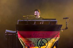 Mike Shinoda, singer of Linkin Park music band, performs in concert at Download. MADRID - JUN 22: Mike Shinoda, singer of Linkin Park music band, performs in royalty free stock photography