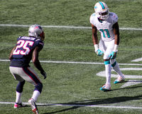 Mike Wallace v. Kyle Arrington. Miami Dolphins WR Mike Wallace (11) lines up against New England Patriots DB Kyle Arrington (25 Royalty Free Stock Photo