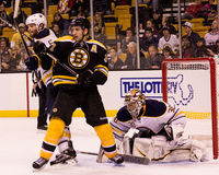 Mike Weber battles Patrice Bergeron in front of Ryan Miller. Stock Photography