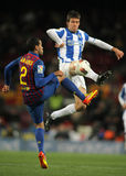 Mikel Aramburu(R) vies with Dani Alves(L) Stock Images