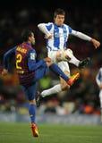 Mikel Aramburu(R) vies with Dani Alves(L) Stock Images