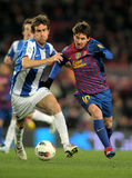 Mikel Gonzalez vies with Leo Messi Stock Image