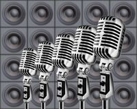 Mikes&Speakers. Retro Microphones Against The Wall Of Speakers Stock Photo