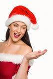 Mikołaj nosi kapelusz kobiety Zdjęcie Royalty Free