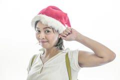 Mikołaj nosi kapelusz kobiety Obrazy Royalty Free
