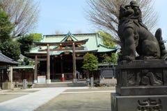 Miko working at Ushima Shrine in Tokyo, near Sumida River Royalty Free Stock Photo